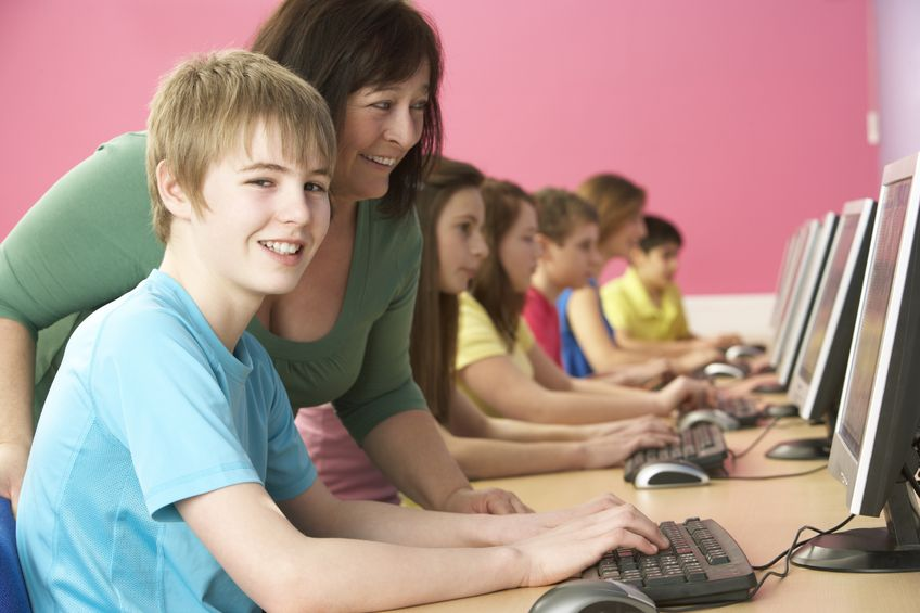 Teacher with students on PCs from 123RF com